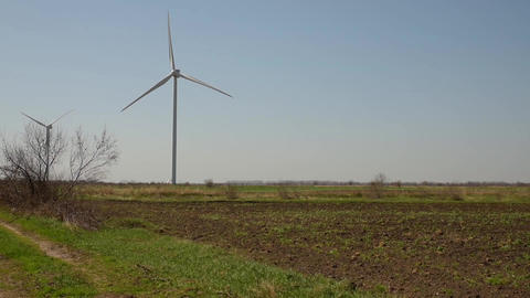 Windmills in the field on a summer GIF