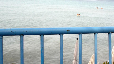 dirty and rusty blue metal railing by the sea Live Action