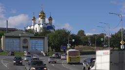 Traffic flow of cars along road on background of Holy Trinity Orthodox Cathedral Footage