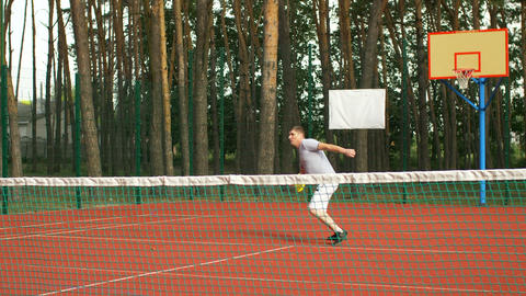 Healthy lifestyle man playing tennis outdoors Live Action