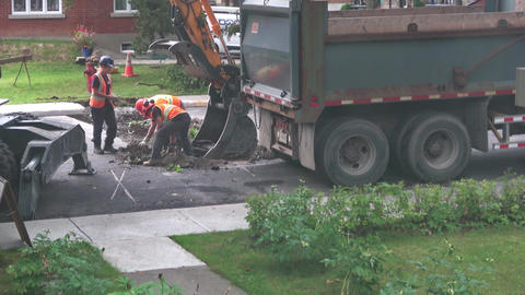 Construction crew put debris into excavator shovel Footage