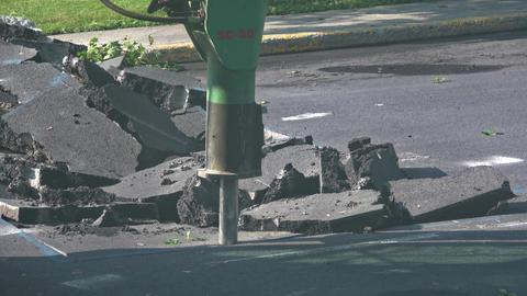 Hydraulic jackhammer breaking , drilling road Footage