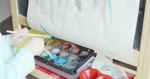 Girl painting picture with watercolor Live Action