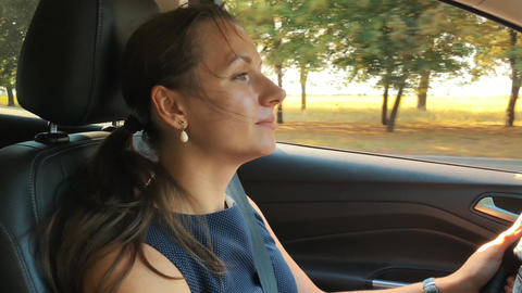 Cheerful woman driving a car, beautiful scenery and…, Live Action