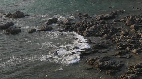 sea tide wave splashing against rock shore GIF