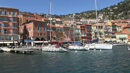 France Cote d'Azur Villefranche sur Mer sailing boats berthed at jetties Footage