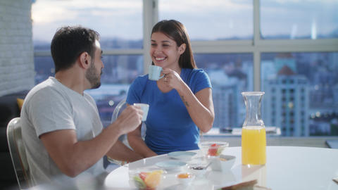 Young Couple Eating Breakfast At Home On Sunday Footage