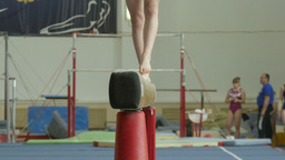 girl gymnast exercises on balance beam Footage