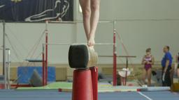 girl gymnast exercises on balance beam Footage
