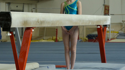 Girl Gymnast Preparing For Exercise On Balance Beam stock footage