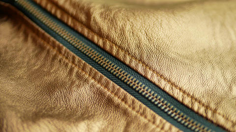 Golden brown leather jacket with zipper are wide opening GIF