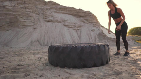 Girl coaches outdoors jumping burpee through the wheel. Workout crossfit workout Footage