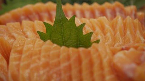salmon sashimi or Raw salmon slice Live Action