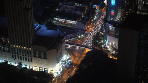 view of the air to the night city with traffic and skyscrapers, corporate Footage