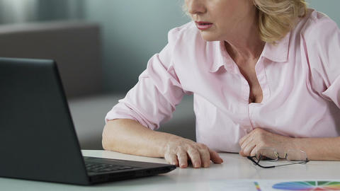 Lucky lady in her 50s reading winner list online, rejoicing her lottery victory Live Action