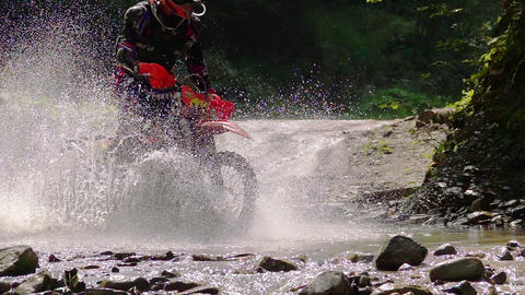 Motocycle Rider Crosses Mountain River
