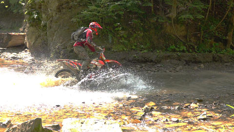 Motocycle Rider Crosses Mountain River 0