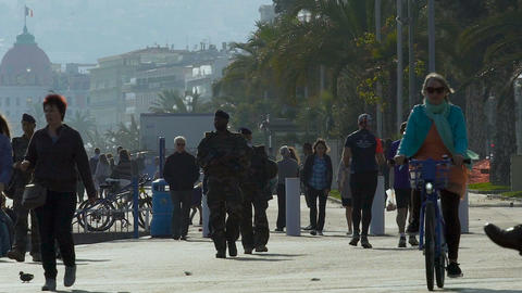 Ordinary day of human life on embankment of Mediterranean Sea in Nice, France Footage