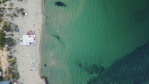Aerial top view of beach with bar and umbrellas - summer tourism concept Footage