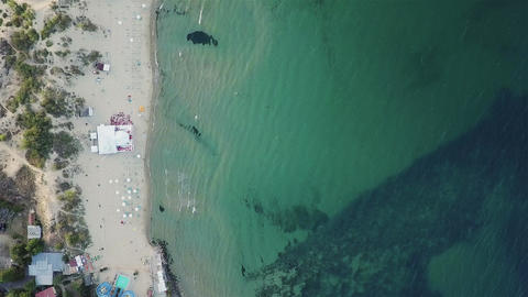 Beach bar, umbrellas, deck chairs and tourists relaxing on in Sunny Beach sea Footage