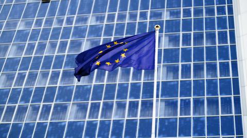 4k footage EU flag fluttering on strong wind against high modern business center Footage