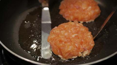 grill salmon mince burger on a pan Live Action