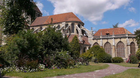 Garden and cathedral exterior in Lisieux, Normandy France Live Action