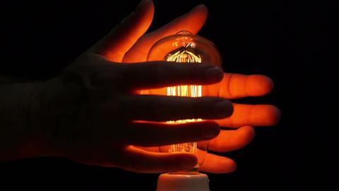 Man Antique Filament Bulb Hands Warming Side Footage