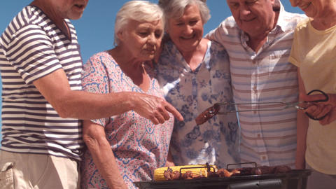 Group of mature people preparing a barbecue Footage