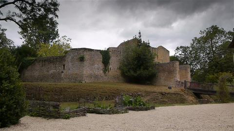 Defense wall of castle Crevecoeur en Auge in Normandy France Live Action