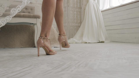 Close up shot of a bride's legs with her new dress on their wedding day Footage