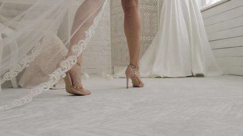 Close up shot of a bride's legs with her new dress on... Stock Video Footage