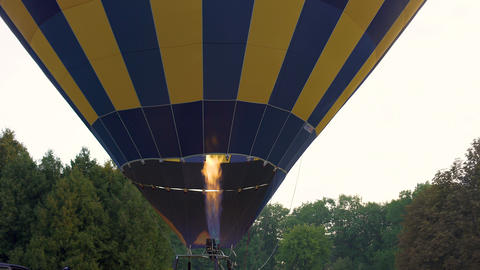 Preparation for flight, hot air balloon burner inflating the envelope, tour Live Action