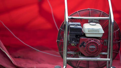 Ventilator blowing heat into envelope, preparation for hot air ballooning show Live Action