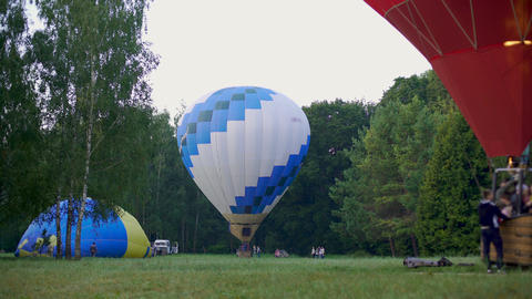 Hot air balloon with passengers taking off the ground, recreational activity Live Action
