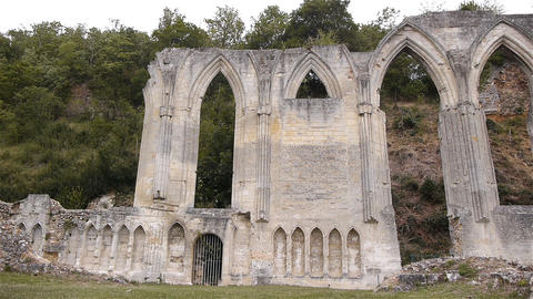 Ruined exterior of priory of Beaumont le Roger, Normandy France, PAN Footage