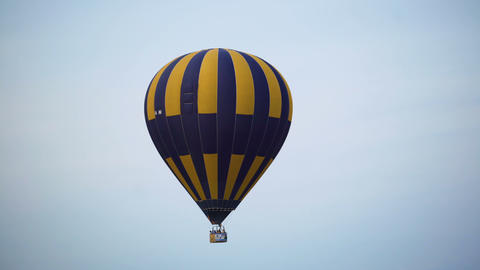 Colorful hot air balloon flying in the sky, freedom and extreme sport, hobby Footage