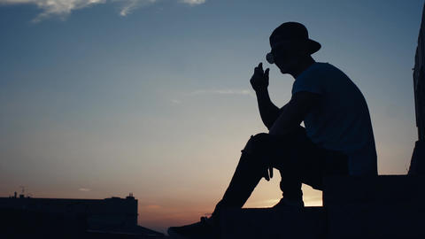 Silhouette Of A Man In The City At Sunset
