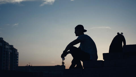 Silhouette Of A Man In The City At Sunset 0