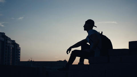 Silhouette Of A Man In The City At Sunset 1