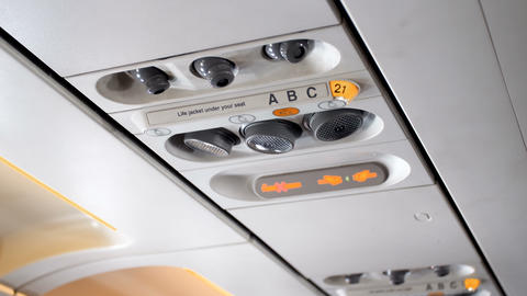 Closeup 4k video of emergency sign and fasten seat beat panel on the ceiling on ライブ動画