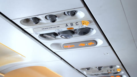 Closeup 4k footage of air cinditioning vents, individual lights and fasten seat ライブ動画