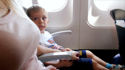 4k footage of nervous and scared little boy during take off in airplane Footage