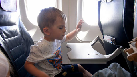 4k footage of adorable 2 years old toddler boy sitting in passenger seat at Archivo