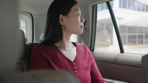 Chinese Business Woman Working In Taxi Going To Work GIF