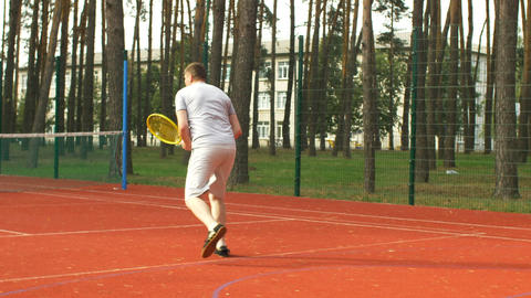 Tennis player running to the net to score a point 영상물