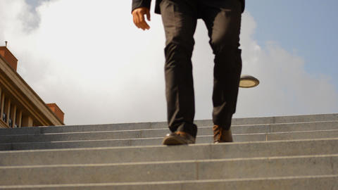 Businessman With Good Shoos Goes Down the Stairs GIF