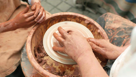 Creation covers a clay pot Footage