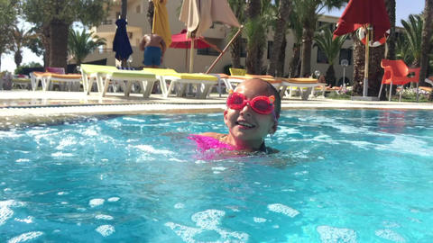 Girl teenager swimming underwater and diving in floating pool in resort hotel 영상물