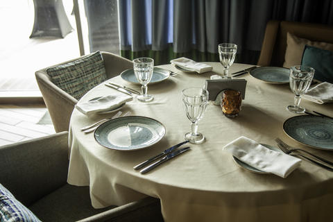 Cured table in the restaurant, cutlery plates with glasses Photo